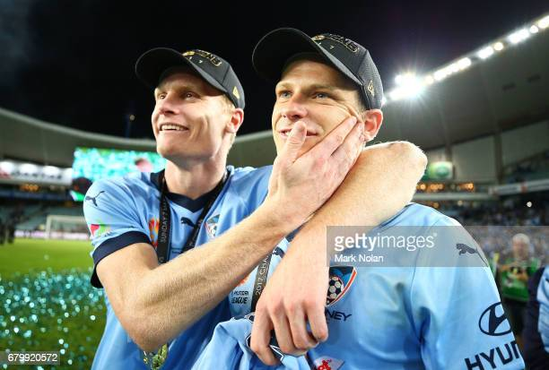 Matt Simon and Alex Wilkinson of Sydney FC celebrates after winning during the 2017 ALeague Grand Final match between Sydney FC and the Melbourne...