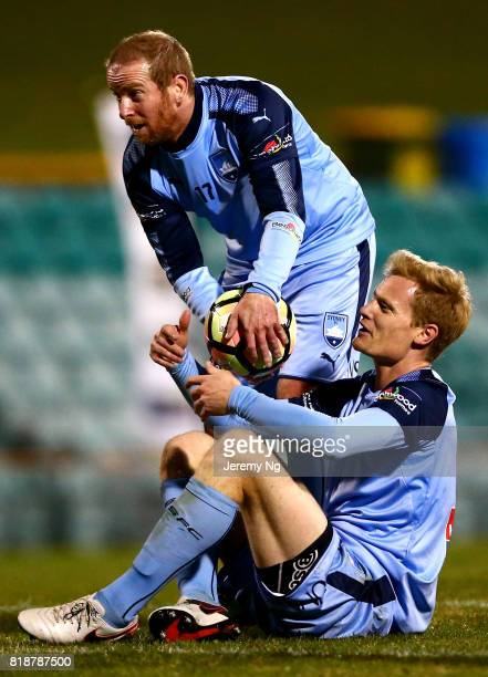 Matt Simon and David Carney of Sydney FC react to a tackle during the 2017 Johnny Warren Challenge match between Sydney FC and Earlwood Wanderers at...