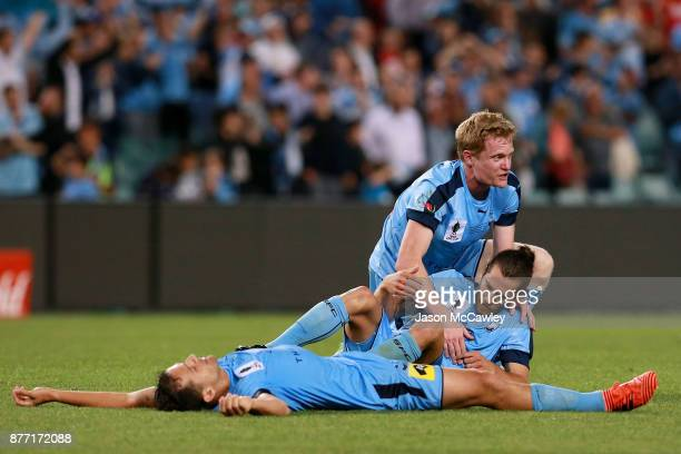 Matt Simon and Joshua Brillante of Sydney celebrate victory at the end of the FFA Cup Final match between Sydney FC and Adelaide United at Allianz...