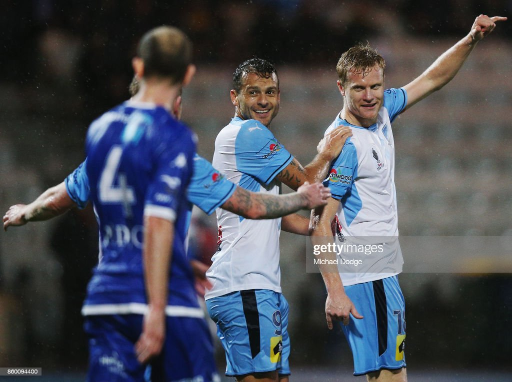 Matt Simon of Sydney FC (R) celebrates a goal with teammates during the FFA Cup Semi Final match between South Melbourne FC and Sydney FC at Lakeside Stadium on October 11, 2017 in Melbourne, Australia.