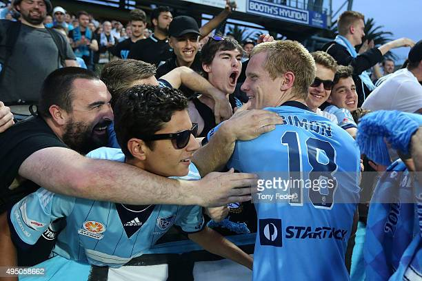 Matt Simon of Sydney FC celebrates with fans after the match during the round four ALeague match between the Central Coast Mariners and Sydney FC at...