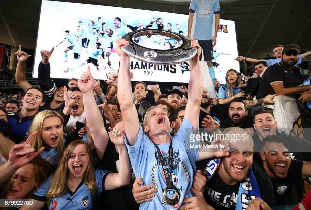 Matt Simon of Sydney FC celebrates with the crowd after winning the 2017 ALeague Grand Final match between Sydney FC and the Melbourne Victory at...