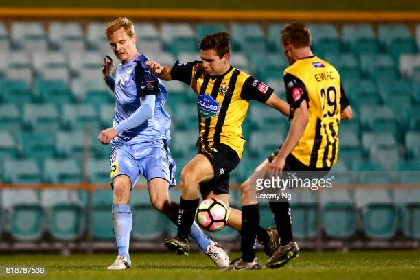 Matt Simon of Sydney FC passes the ball under pressure during the 2017 Johnny Warren Challenge match between Sydney FC and Earlwood Wanderers at...