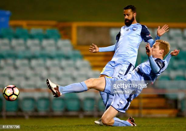 Matt Simon of Sydney FC shoots the ball as Alex Brosque looks on during the 2017 Johnny Warren Challenge match between Sydney FC and Earlwood...