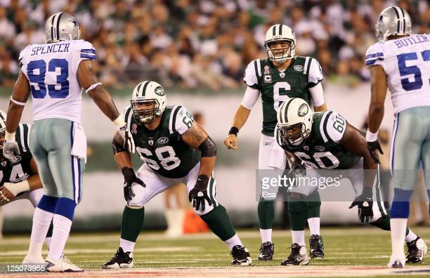 Matt Slauson and D'Brickashaw Ferguson of the New York Jets line up at the line of scrimmage in front of quarterback Mark Sanchez against the Dallas...