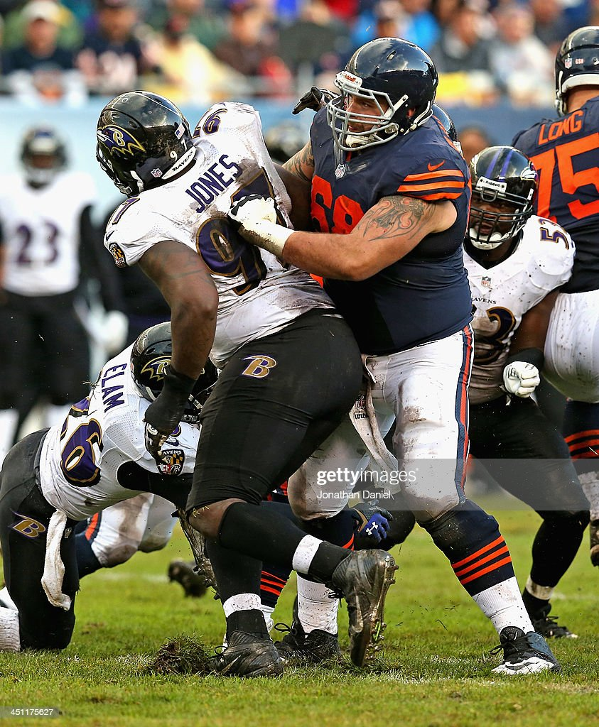 Matt Slauson #68 of the Chicago Bears blocks Arthur Jones #97 of the Baltimore Ravens at Soldier Field on November 17, 2013 in Chicago, Illinois. The Bears defeated the Ravens 23-20 in overtime.