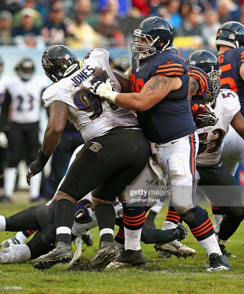 Matt Slauson #68 of the Chicago Bears blocks Arthur Jones #97 of the Baltimore Ravens at Soldier Field on November 17, 2013 in Chicago, Illinois. The Bears defeated the Ravens 23-20 in overtime.