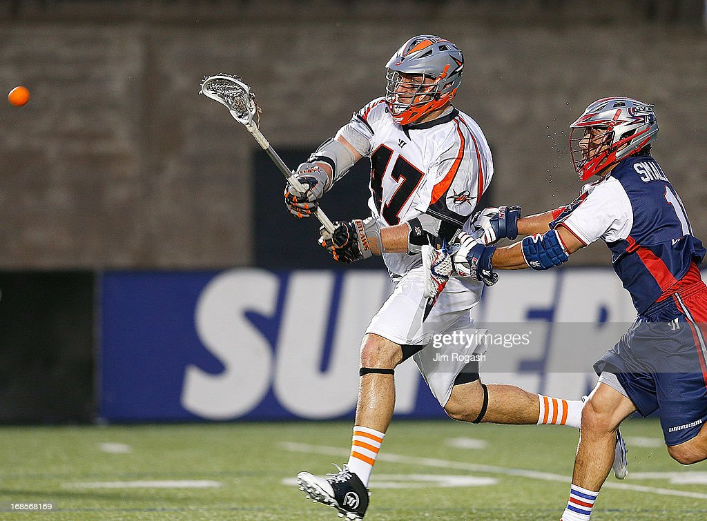 Matt Smalley #11 of the Boston Cannons cannot stop Anthony Kelly #47 of the Denver Outlaws from scoring in the second quarter at Harvard Stadium on May 11, 2013 in Boston, Massachusetts.