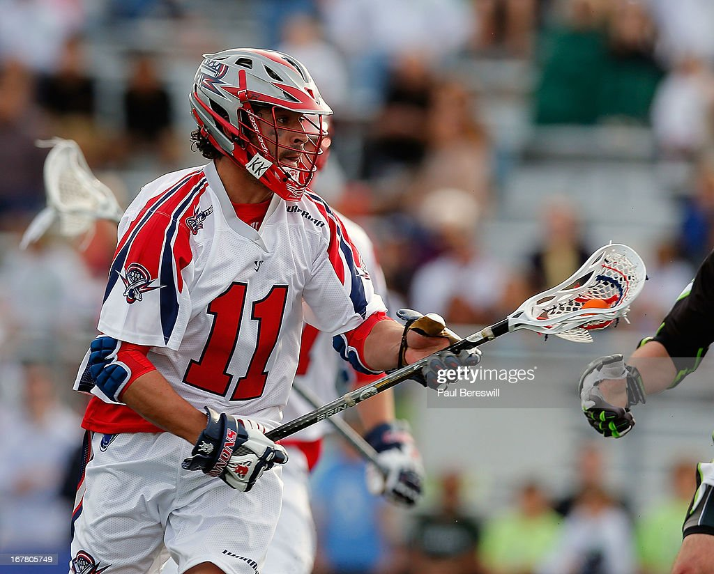 Matt Smalley #11 of the Boston Cannons runs with the ball during a Major League Lacrosse game against the New York Lizards at James M. Shuart Stadium on April 28, 2013 in Hempstead, New York.