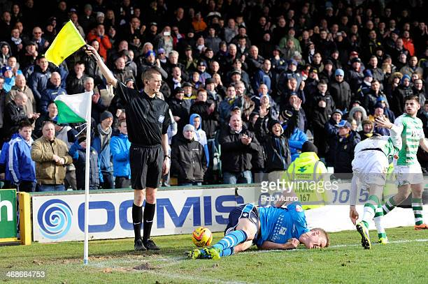 Matt Smith of Leeds United goes down injured during the Sky Bet Championship match between Yeovil Town and Leeds United at Huish Park on February 08...