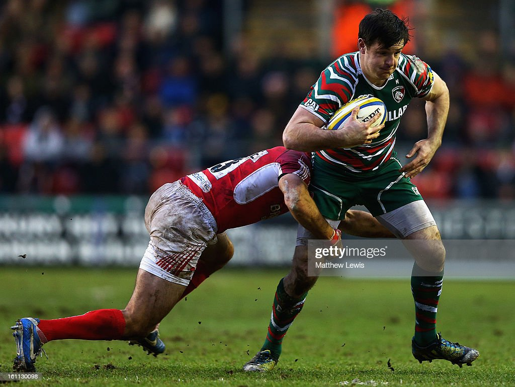 Matt Smith of Leicester is tackled by Gonzalo Tiesi of London Welsh during the Aviva Premiership match between Leicester Tigers and London Welsh at Welford Road on February 9, 2013 in Leicester, England.