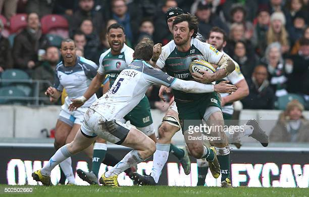 Matt Smith of Leicester is tackled by Simon Hammersley during the Aviva Premiership match between Leicester Tigers and Newcastle Falcons at Welford...