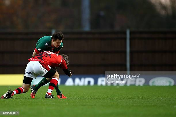 Matt Smith of Leicester Tigers is tackled by Nic Reynolds of London Welsh during the Aviva Premiership match between London Welsh and Leicester...