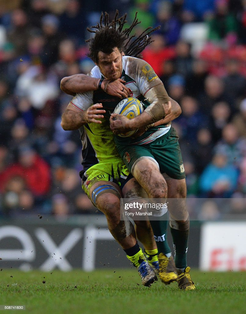 <a gi-track='captionPersonalityLinkClicked' href=/galleries/search?phrase=Matt+Smith+-+Rugby+Player&family=editorial&specificpeople=6877374 ng-click='$event.stopPropagation()'>Matt Smith</a> of Leicester Tigers is tackled by <a gi-track='captionPersonalityLinkClicked' href=/galleries/search?phrase=Sam+Tuitupou&family=editorial&specificpeople=540375 ng-click='$event.stopPropagation()'>Sam Tuitupou</a> of Sale Sharks during the Aviva Premiership match between Leicester Tigers and Sale Sharks at Welford Road on February 6, 2016 in Leicester, England.