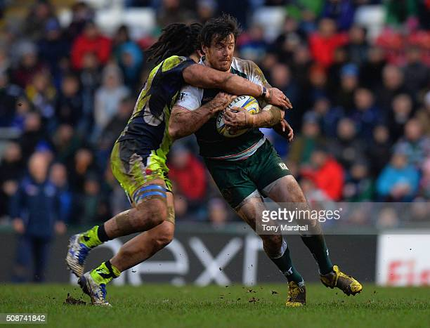 Matt Smith of Leicester Tigers is tackled by Sam Tuitupou of Sale Sharks during the Aviva Premiership match between Leicester Tigers and Sale Sharks...