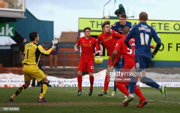 Matt Smith of Oldham Athletic goes up for a header prior to Martin Skrtel of Liverpool scoring an own goal during the FA Cup with Budweiser Fourth...