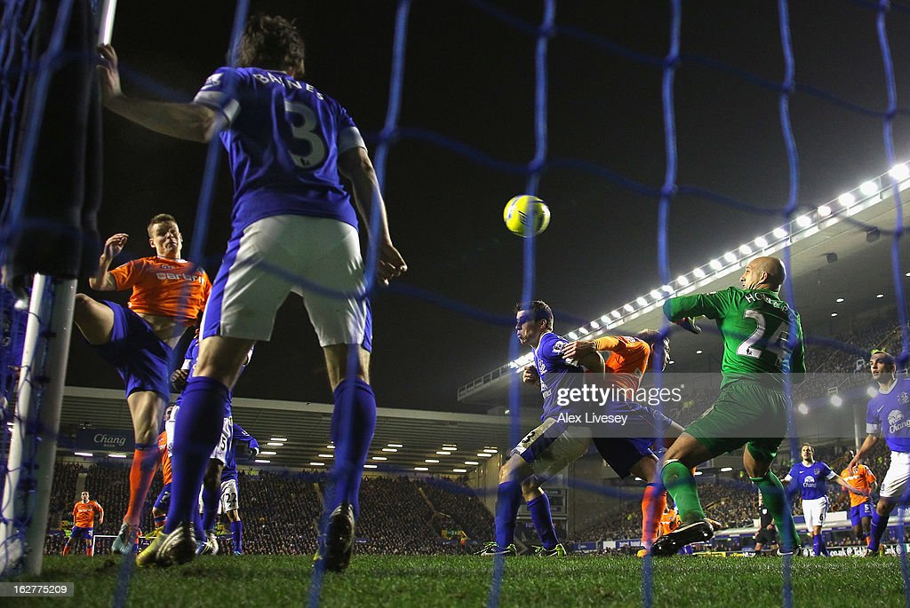 Matt Smith of Oldham Athletic scores his goal during the FA Cup fifth round replay match between Everton and Oldham Athletic at Goodison Park on February 26, 2013 in Liverpool, England.