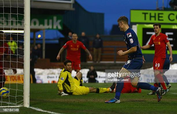 Matt Smith of Oldham Athletic scores his team's second goal during the FA Cup with Budweiser Fourth Round match between Oldham Athletic and Liverpool...