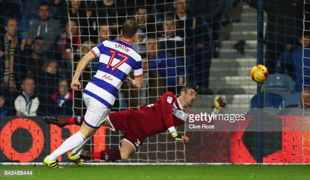 Matt Smith of QPR scores their first goal past goalkeeper Matt Gilks of Wigan Athletic during the Sky Bet Championship match between Queens Park...