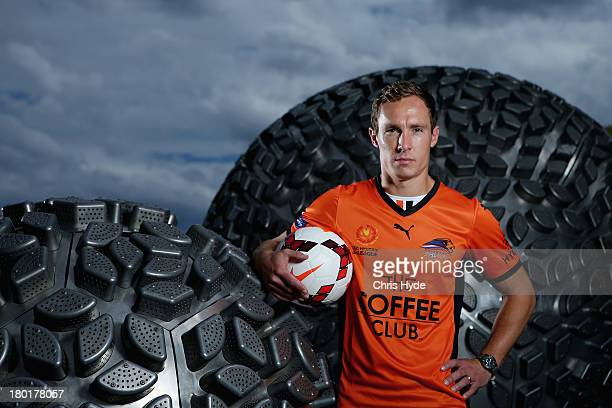 Matt Smith poses after the Brisbane Roar 2013/14 ALeague kit launch at Queen Street Mall on September 10 2013 in Brisbane Australia