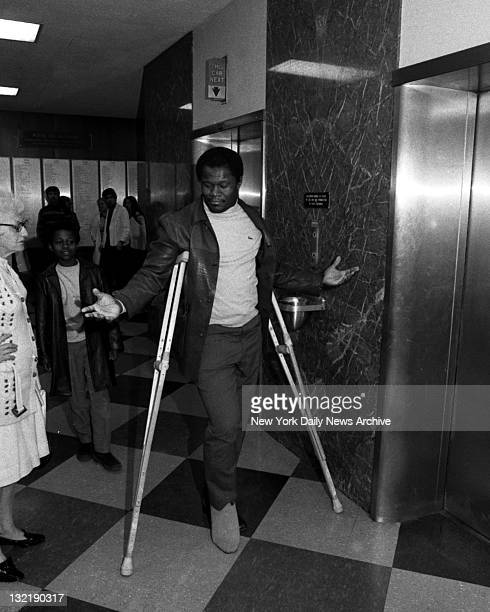 Matt Snell hopping out of the picture with ruptured Achilles tendon at Lenox Hill Hospital Look for him in 1971