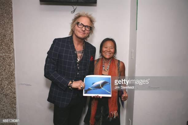 Matt Sorum and skateboard legend and activist Peggy Oki backstage at the Kings of Chaos benefit concert for Ric O'Barry's Dolphin Project at the...