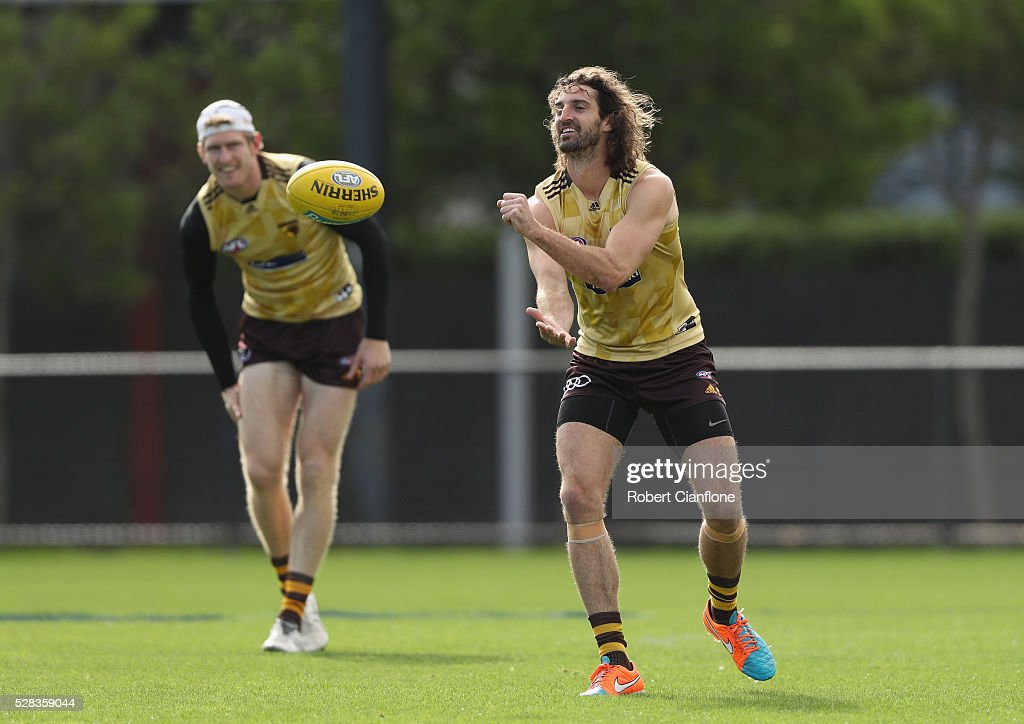 Matt Spangher of the Hawks handballs during a Hawthorn Hawks AFL media session at Waverley Park on May 5, 2016 in Melbourne, Australia.