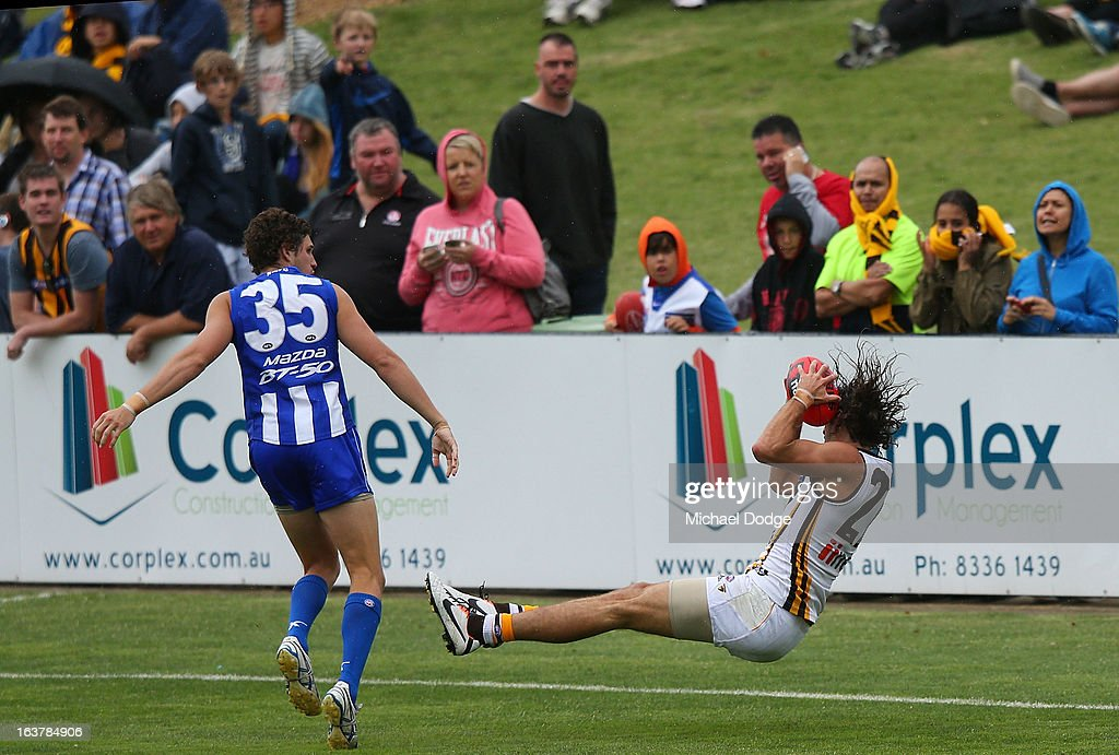 Matt Spangher of the Hawks marks the ball during the AFL NAB Cup match between the North Melbourne Kangaroos and the Hawthorn Hawks at Highgate Recreational Reserve on March 16, 2013 in Craigieburn, Australia.