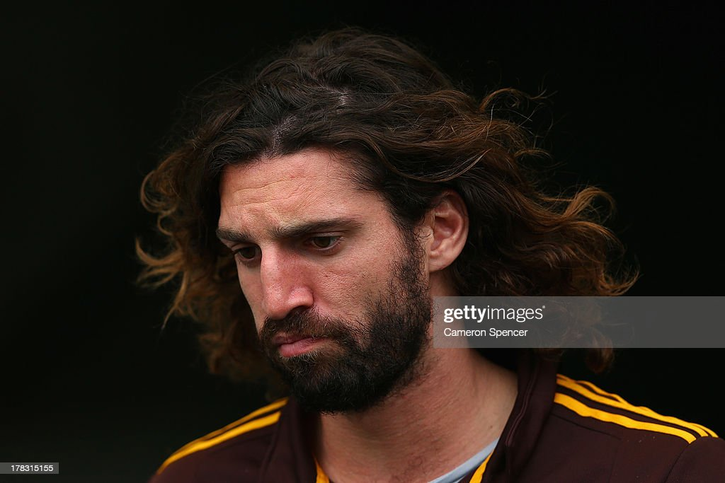 Matt Spangher of the Hawks walks onto the field during a Hawthorn Hawks AFL training session at ANZ Stadium on August 29, 2013 in Sydney, Australia.