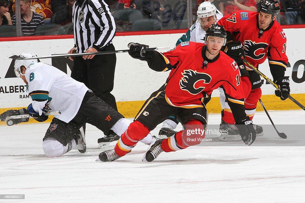 Matt Stajan #18 and Lance Bouma #17 of the Calgary Flames skate against Joe Pavelski #8 and Dan Boyle #22 of the San Jose Sharks at Scotiabank Saddledome on March 24, 2014 in Calgary, Alberta, Canada.