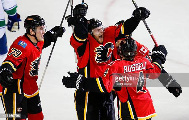Matt Stajan celebrates his game winning goal with Michael Ferland Kris Russell and David Jones against the Vancouver Canucks in Game Six of the...