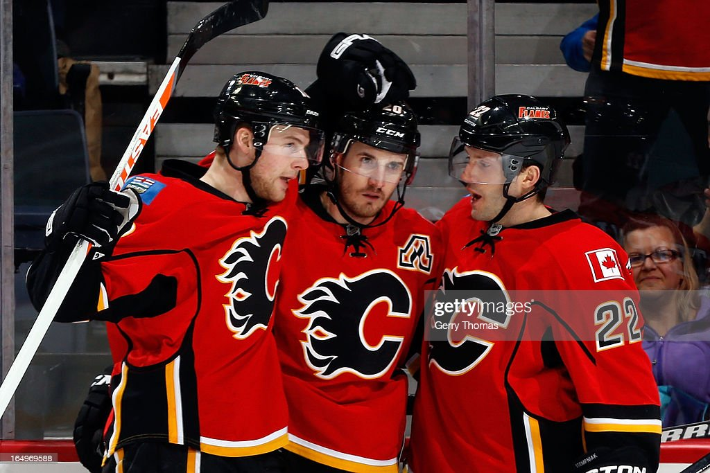 Matt Stajan #18, <a gi-track='captionPersonalityLinkClicked' href=/galleries/search?phrase=Curtis+Glencross&family=editorial&specificpeople=2190970 ng-click='$event.stopPropagation()'>Curtis Glencross</a> #20 and <a gi-track='captionPersonalityLinkClicked' href=/galleries/search?phrase=Lee+Stempniak&family=editorial&specificpeople=575240 ng-click='$event.stopPropagation()'>Lee Stempniak</a> #22 of the Calgary Flames celebrates a goal against the Columbus Blue Jackets on March 29, 2013 at the Scotiabank Saddledome in Calgary, Alberta, Canada.