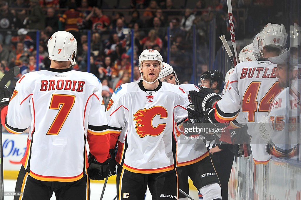 Matt Stajan #18 of the Calgary Flames celebrates after a goal in a game against the Edmonton Oilers on March 22, 2014 at Rexall Place in Edmonton, Alberta, Canada.