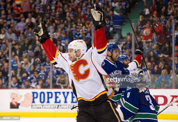 Matt Stajan of the Calgary Flames celebrates teammates David Jones goal against the Vancouver Canucks in Game One of the Western Conference...