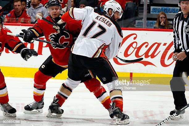 Matt Stajan of the Calgary Flames faces off against Ryan Kesler of the Anaheim Ducks during an NHL game at Scotiabank Saddledome on December 29 2015...