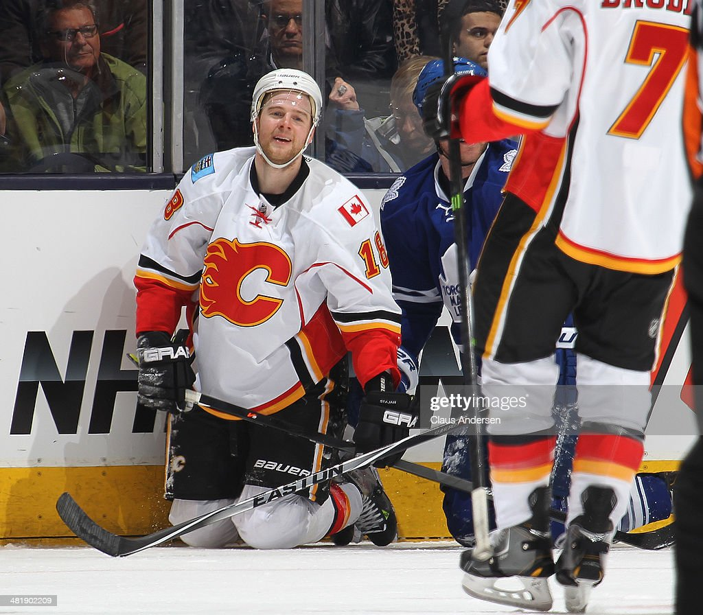 Matt Stajan #18 of the Calgary Flames is all smiles after his goal against the Toronto Maple Leafs during an NHL game at the Air Canada Centre on April 1, 2014 in Toronto, Ontario, Canada.