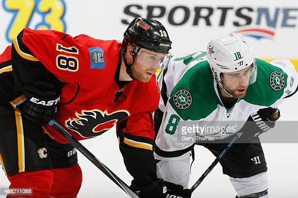 Matt Stajan of the Calgary Flames prepares to face off against Patrick Eaves of the Dallas Stars at Scotiabank Saddledome on March 25 2015 in Calgary...
