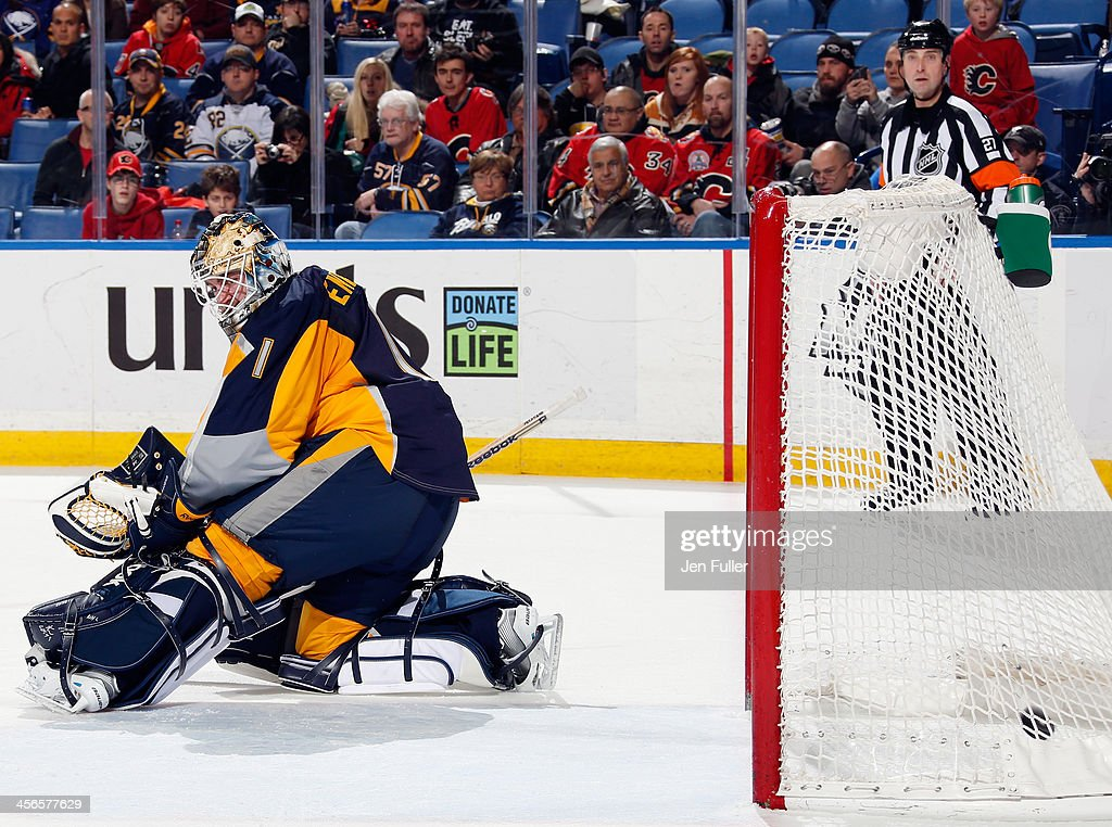 Matt Stajan #18 of the Calgary Flames (not pictured) scores an overtime goal against <a gi-track='captionPersonalityLinkClicked' href=/galleries/search?phrase=Jhonas+Enroth&family=editorial&specificpeople=570456 ng-click='$event.stopPropagation()'>Jhonas Enroth</a> #1 of the Buffalo Sabres at First Niagara Center on December 14, 2013 in Buffalo, New York. Calgary defeated Buffalo 2-1.