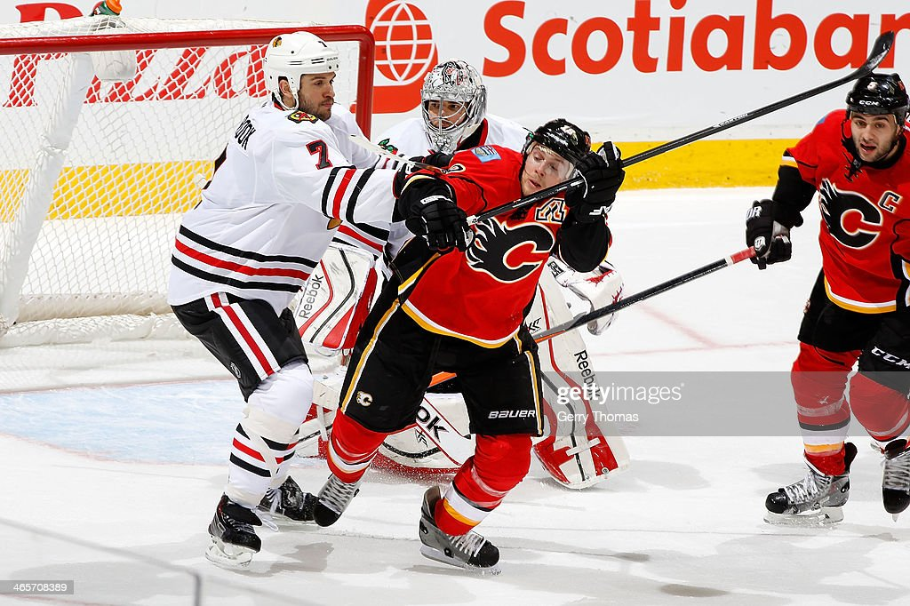 Matt Stajan #18 of the Calgary Flames skates against <a gi-track='captionPersonalityLinkClicked' href=/galleries/search?phrase=Brent+Seabrook&family=editorial&specificpeople=638862 ng-click='$event.stopPropagation()'>Brent Seabrook</a> #7 of the Chicago Blackhawks at Scotiabank Saddledome on January 28, 2014 in Calgary, Alberta, Canada.