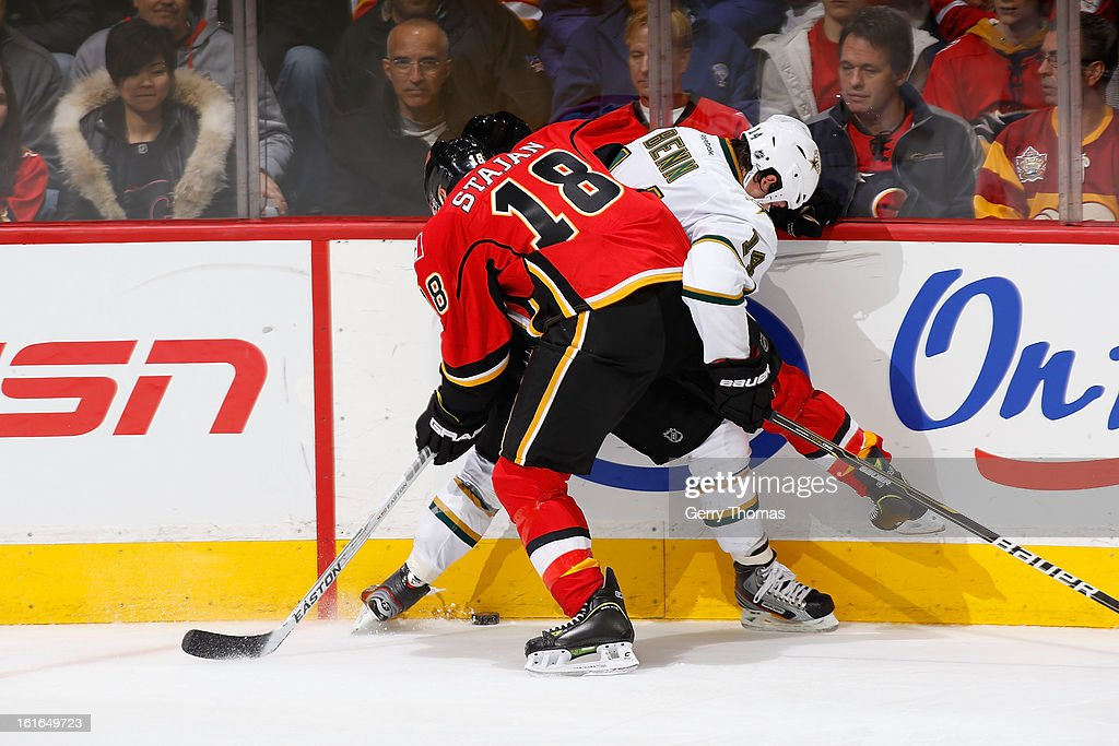 Matt Stajan #18 of the Calgary Flames skates against <a gi-track='captionPersonalityLinkClicked' href=/galleries/search?phrase=Jamie+Benn&family=editorial&specificpeople=4595070 ng-click='$event.stopPropagation()'>Jamie Benn</a> #14 of the Dallas Stars on February 13, 2013 at the Scotiabank Saddledome in Calgary, Alberta, Canada.