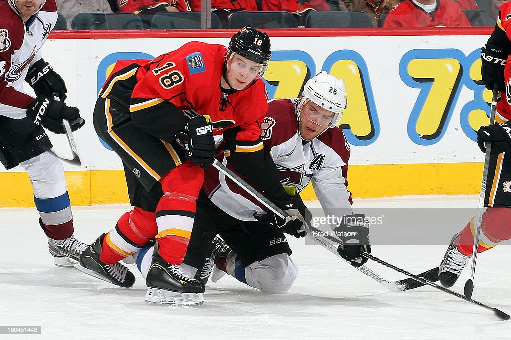 Matt Stajan #18 of the Calgary Flames skates against <a gi-track='captionPersonalityLinkClicked' href=/galleries/search?phrase=Paul+Stastny&family=editorial&specificpeople=2494330 ng-click='$event.stopPropagation()'>Paul Stastny</a> #26 of the Colorado Avalanche on January 31, 2013 at the Scotiabank Saddledome in Calgary, Alberta, Canada.