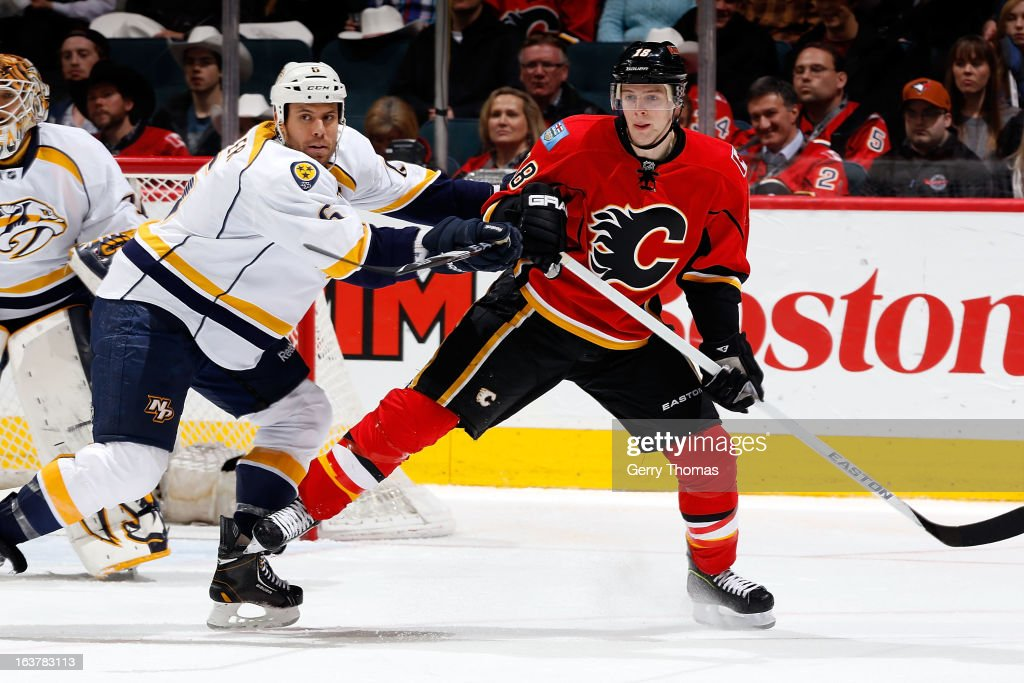 Matt Stajan #18 of the Calgary Flames skates against <a gi-track='captionPersonalityLinkClicked' href=/galleries/search?phrase=Shea+Weber&family=editorial&specificpeople=554412 ng-click='$event.stopPropagation()'>Shea Weber</a> #6 of the Nashville Predators on March 15, 2013 at the Scotiabank Saddledome in Calgary, Alberta, Canada.