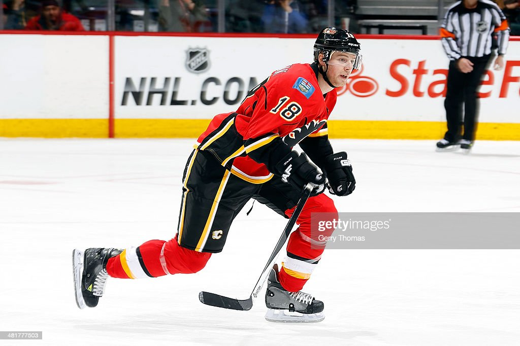 Matt Stajan #18 of the Calgary Flames skates against the Buffalo Sabres at Scotiabank Saddledome on March 18, 2014 in Calgary, Alberta, Canada. The Flames won 3-1.