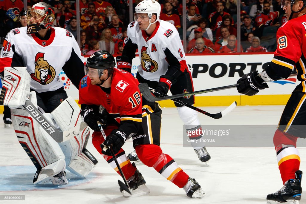 Matt Stajan #18 of the Calgary Flames skates against the Ottawa Senators during an NHL game on October 13, 2017 at the Scotiabank Saddledome in Calgary, Alberta, Canada.