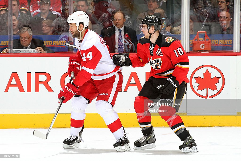 Matt Stajan #18 of the Calgary Flames skates against <a gi-track='captionPersonalityLinkClicked' href=/galleries/search?phrase=Todd+Bertuzzi&family=editorial&specificpeople=202476 ng-click='$event.stopPropagation()'>Todd Bertuzzi</a> #44 of the Detroit Red Wings at Scotiabank Saddledome on November 1, 2013 in Calgary, Alberta, Canada.
