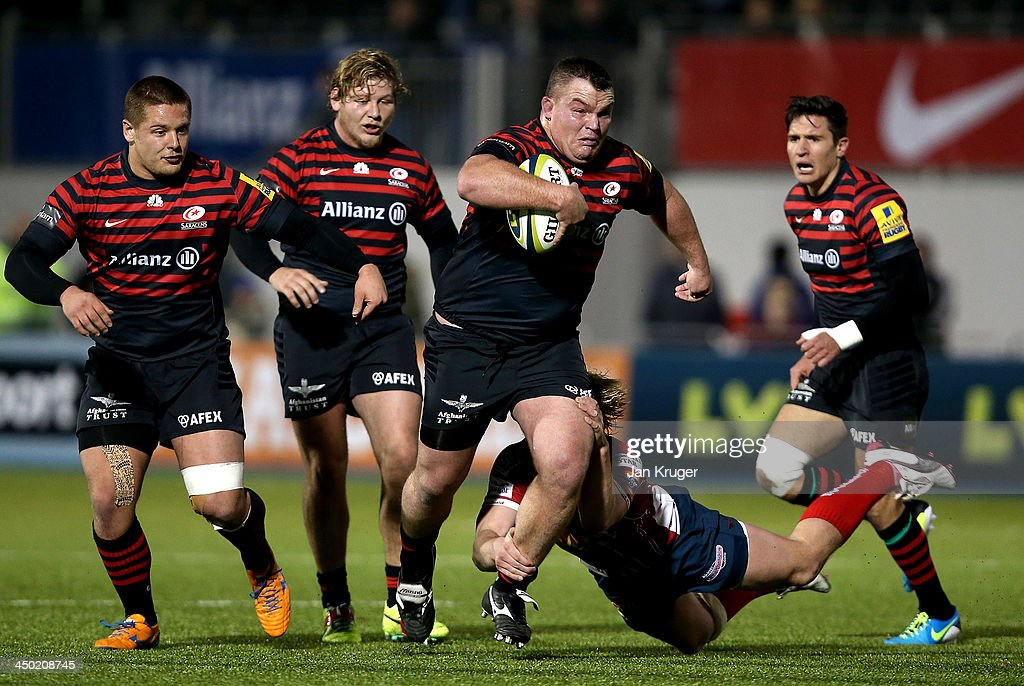 <a gi-track='captionPersonalityLinkClicked' href=/galleries/search?phrase=Matt+Stevens&family=editorial&specificpeople=209047 ng-click='$event.stopPropagation()'>Matt Stevens</a> of Saracens crashes through the tackle of Dan Thomas of Scarlets during the LV= Cup match between Saracens and Scarlets at Allianz Park on November 17, 2013 in Barnet, England.