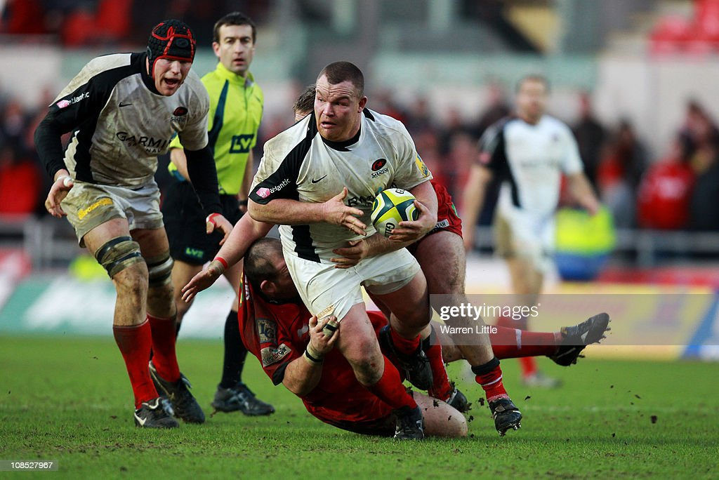 <a gi-track='captionPersonalityLinkClicked' href=/galleries/search?phrase=Matt+Stevens&family=editorial&specificpeople=209047 ng-click='$event.stopPropagation()'>Matt Stevens</a> of Saracens is tackled by Scarlets Captain, Phil John during the LV Anglo Welsh Cup between Scarlets and Saracens at Parc y Scarlets on January 29, 2011 in Llanelli, Wales.