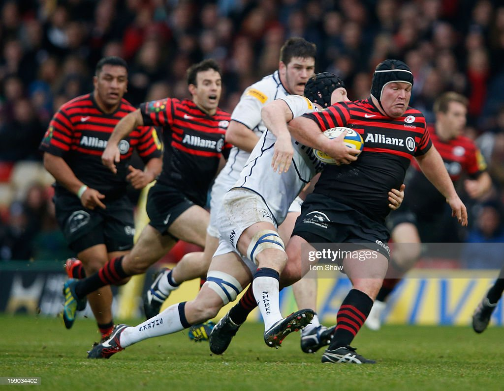 Matt Stevens of Saracens is tackled during the Aviva Premiership match between Saracens and Sale Sharks at Vicarage Road on January 6, 2013 in Watford, England.