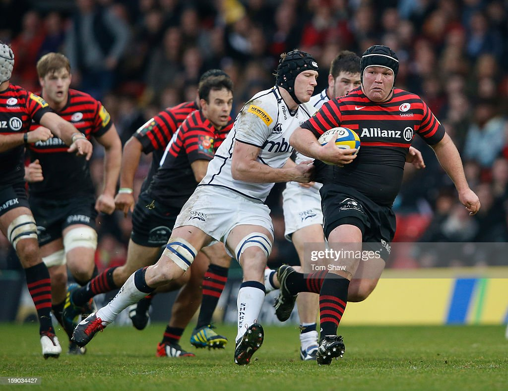 <a gi-track='captionPersonalityLinkClicked' href=/galleries/search?phrase=Matt+Stevens&family=editorial&specificpeople=209047 ng-click='$event.stopPropagation()'>Matt Stevens</a> of Saracens is tackled during the Aviva Premiership match between Saracens and Sale Sharks at Vicarage Road on January 6, 2013 in Watford, England.