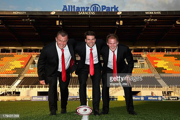 Matt Stevens Schalk Brits and Rhys Gill of Saracens pose with their new Apsley taylored suits during the season launch at Allianz Park on September 3...